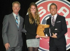 Ashley Meier receives the adidas Player of the Year plaque from Paul and Taylor